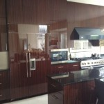 Handmade Cabinetry Specialists in High Sheen with Matched Grain Rosewood Veneer for Contemporary Designs.